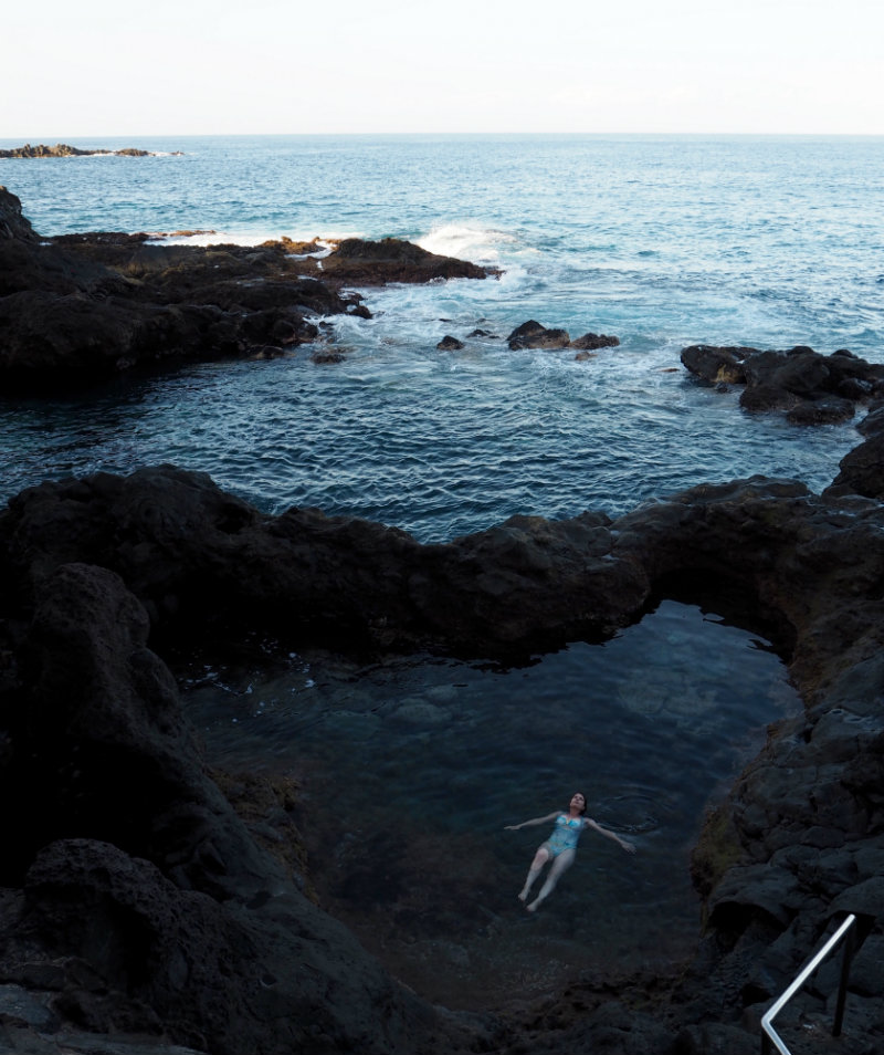 Thoughts I Had in Tenerife - Elle floats in a volcanic rock pool