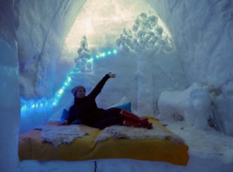 Elle Croft posing in Balea Lake Ice Hotel, Romania - What is Sleeping in an Ice Hotel Really Like?